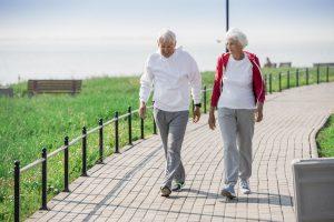 Active Senior Couple Walking Outdoors