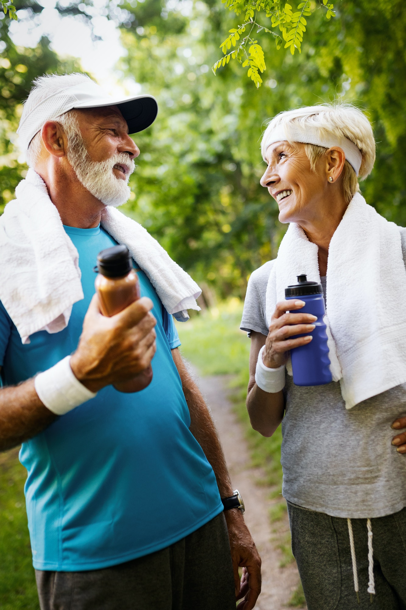 Happy senior couple staying fit by sport running