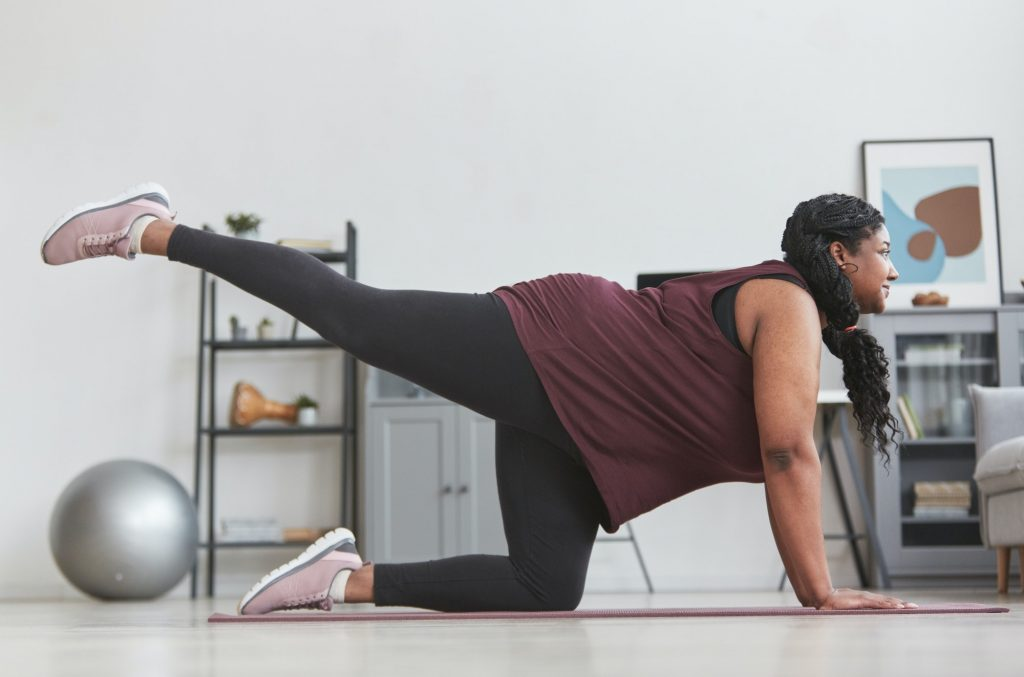 Overweight African American Woman Stretching